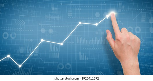 Person points to growth graph on graphical display.