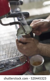 Person Preparing Milk Froth for Coffee