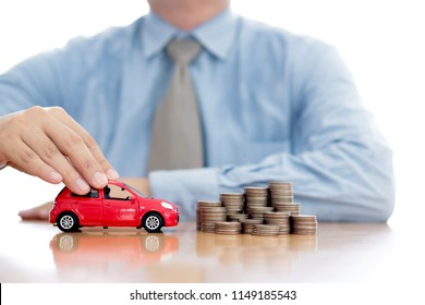 Person Protecting Increasing Stacked Coins And Car