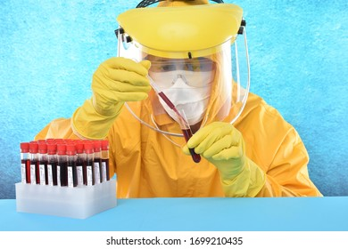 Person in a protective suit doing covid-19 research