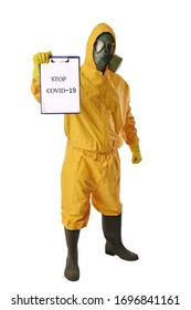 Person in a protective suit and a gas mask showing stop covid-19 sign, isolated on white background
