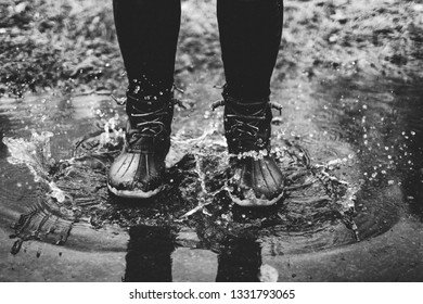 A person in a puddle of water.