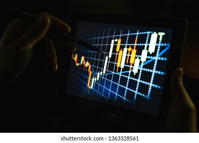 A person pursuing a stock market or a trading chart on forex in a graphical concept suitable for financial investment or business ideas and all art work. Abstract financial background