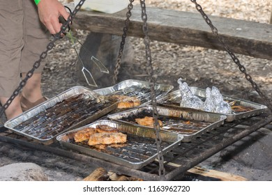 Person puts meat on the swing grill in grill bowl