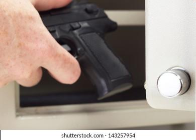Person putting firearm in gun safe