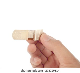 Person putting a plaster on finger isolated on white background