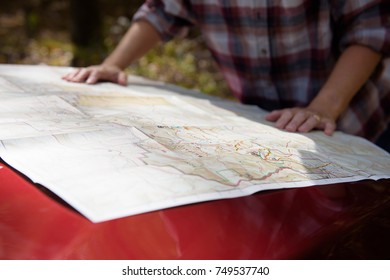 Person reading a map.