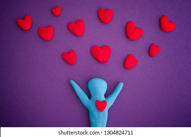 Person with red hearts. Person and Hearts are made out of play clay (plasticine).