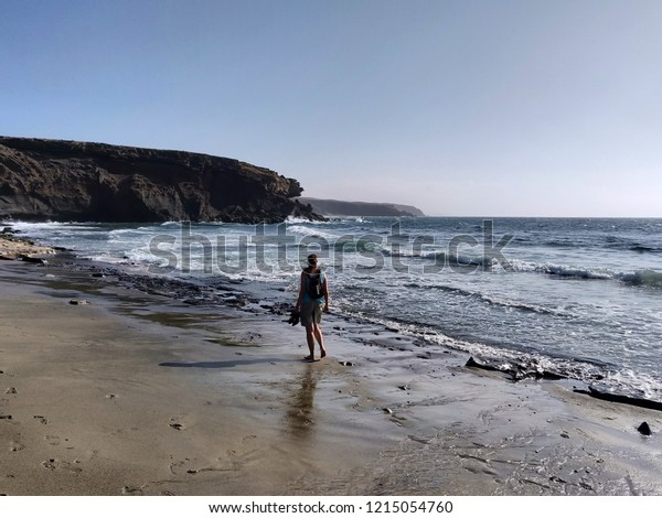 A person at the sea