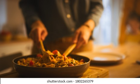 Person Serving Delicious Looking Pasta on the Plate. Serving Profesionally Cooked Pasta Dish in the Restaurant or for Romantic Dinner Meal at Home. Close-up Shot