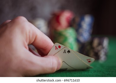 Person showing deck at poker game