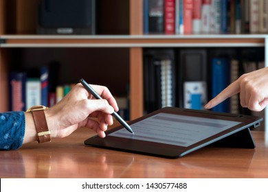 Person signing a document digitally on a tablet