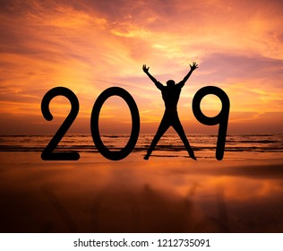 Person silhouette jumping in New Year 2019