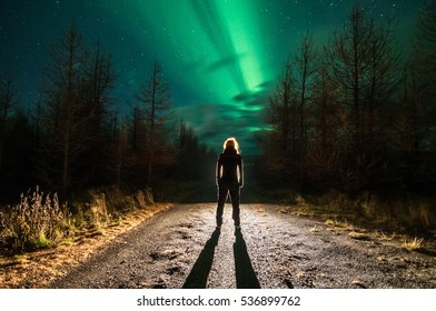Person silhouette with northern lights in Iceland