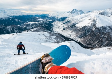 person is sitting in the mountain and watching beautiful mountain view