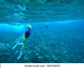 Person snorkeling in Molokini Crater, Maui, Hawaii.