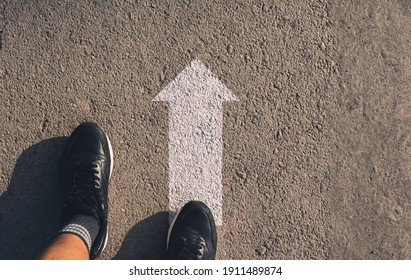 A person standing at the crossroad and get to decision which way to go. Ways to choose concept.