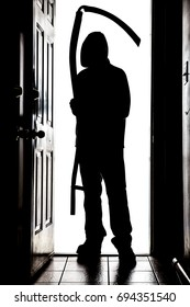 Person standing at doorway threshold, in silhouette with grim reaper style scythe
