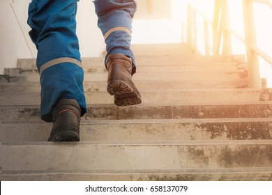 Person is stepping up the stairs with sunlight, Stepping to succeed, Break through obstacles