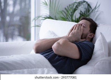 Person suffering from insomnia trying to get some sleep