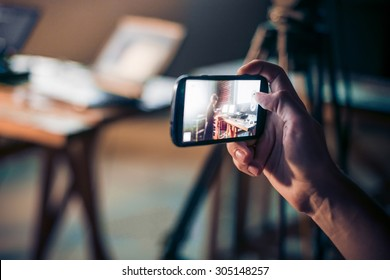 Person is taking photo with a smartphone.