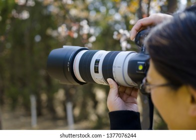A person taking pictures with a camera