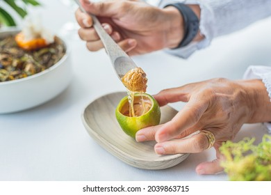 a person tasting a haute cuisine dish based on lemon, foie grass and honey. Gourmet concept and haute cuisine. - Shutterstock ID 2039863715