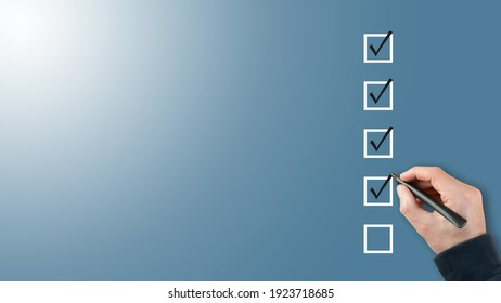 person ticking checkboxes with marker pen on checklist or to-do-list with copy space