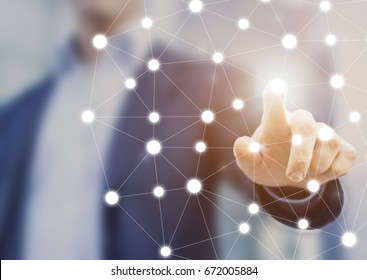 Person touching a network chart showing connections between nodes or servers, concept about the world wide web internet and data communications