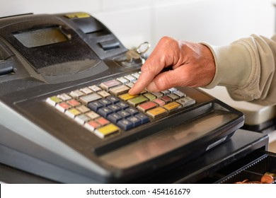 Person typing on old merchant checkout