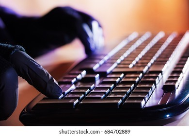 A person uses the keyboard of a computer