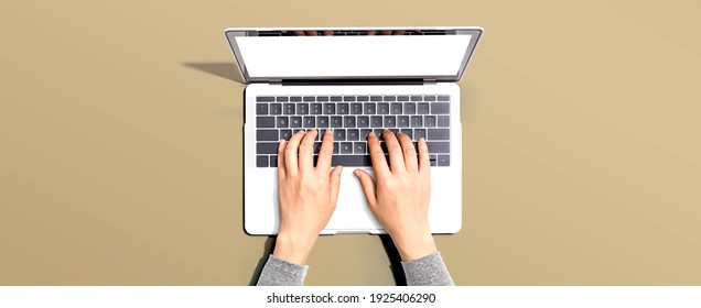 Person using a laptop computer from above