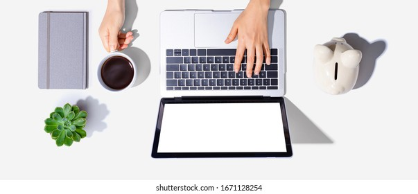 Person using a laptop computer - top view