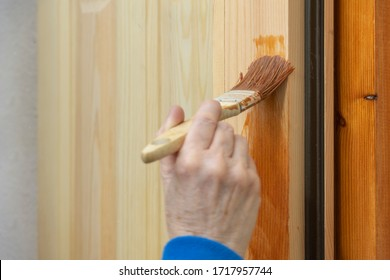 person-varnishing-wooden-window-260nw-17