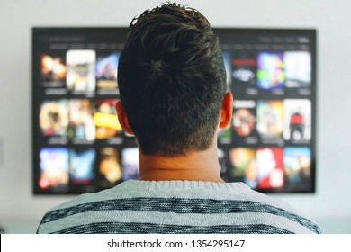 Person watching TV shows on a streaming service.