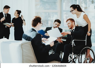 Person in Wheelchair. Healthy Woman. Panoramic View. White Interior. People with Limited Opportunities. Business Meeting at Office. Work Process. Business Suits. Friends Disabled. Man in Wheelchair.