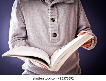 person who is looking through a book