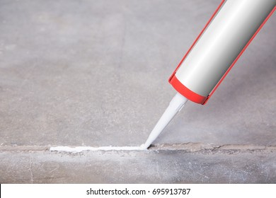 A person will seize a crack with silicone and sealant