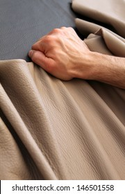 a person work leather to make a sofa