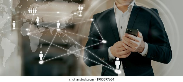 A person working in a business center. remote work and the concept of networking between people on the Internet. Global business network. Online courses male businessman background.