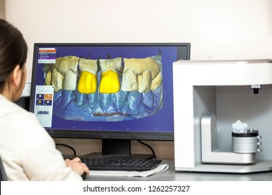 Person working on computer with dental software platform for mak