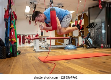 Person works in a well equipped gym, proprioceptive training, core stability, injury prevention