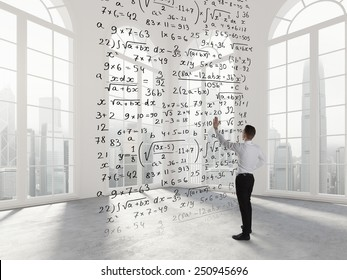 Person write math formula in an empty space