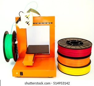 Personal 3d printer and abs or pla filament coils next to him, on a white background.