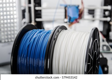Personal 3d printer and abs or pla filament coils next to him.
