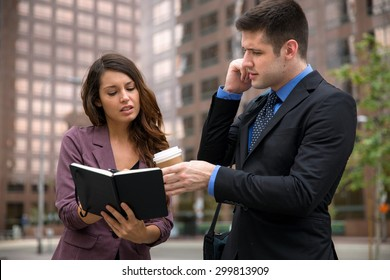 Personal assistant with boss on the move fast pace high stress occupation downtown urban buildings