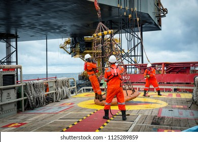 Personal basket tranfer form  supply boat to oil&gas rig offshore during crew change by boat.