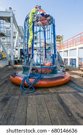 Personal basket transfer on deck of construction barge at oil field