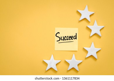 Personal and business success. Growth and development. Aim and objective to work. Succeed memo and stars. Copy space.