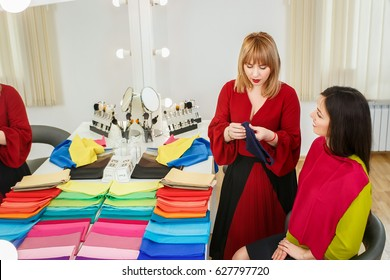 personal color analysis consultation. Color type test. Stylist determines the colors that best suit an individual based on client natural colorings. Consultant works with set of colorful shawls
